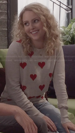 Carrie's beige and red heart sweater and polka dot jeans on The Carrie Diaries