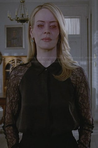 Cordelia's black lace sleeve collared shirt on American Horror Story