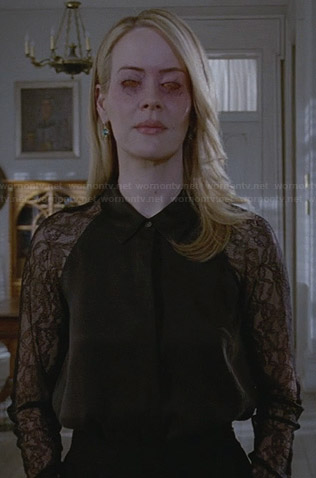 Cordelia's black shirt with lace sleeves on AHS Coven