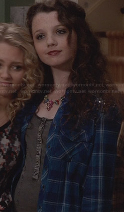 Dorrit's blue plaid studded shirt on The Carrie Diaries