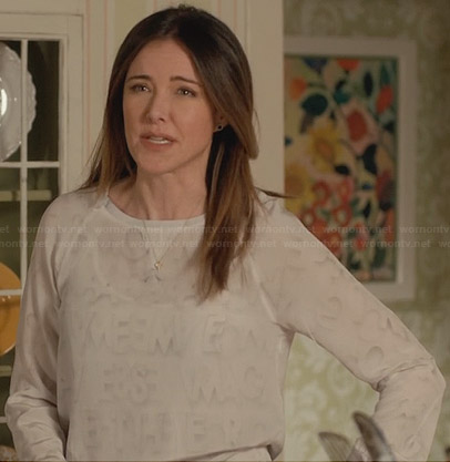 Ellie's white sweatshirt with faded letter print on Cougar Town