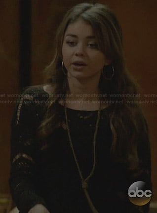 Haley's black crochet sweater on Modern Family