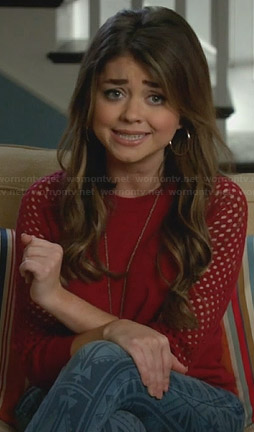 Haley's red perforated sleeve sweater on Modern Family