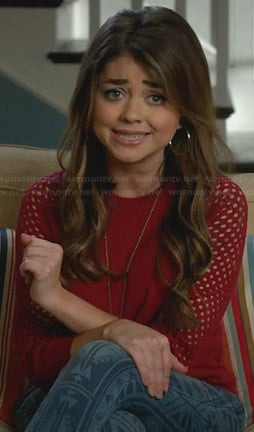 Haley's red mesh sleeve sweater and printed jeans on Modern Family