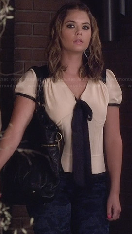 Hanna's white blouse with black contrast bow on Pretty Little Liars