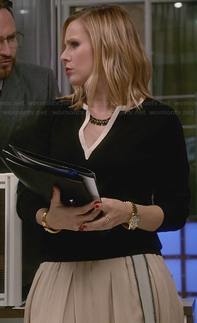 Jeannie's cream pleated skirt and black split-neck sweater on House of Lies