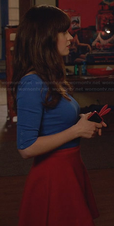 Jess's blue half-sleeve top and red skirt on New Girl