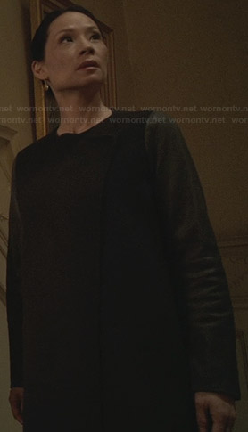 Joan's black asymmetric leather sleeved coat on Elementary