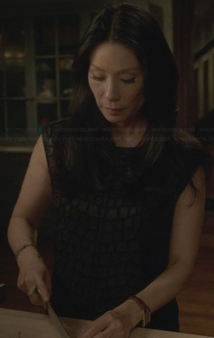 Joan's black scaled leather pattern dress on Elementary