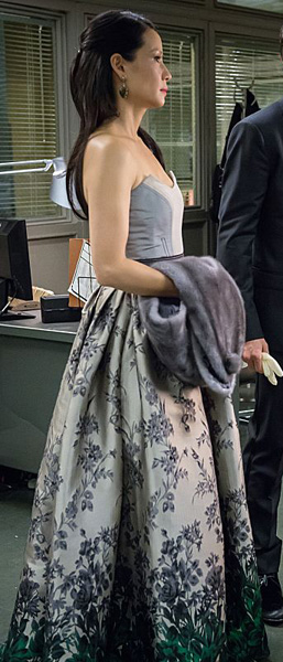 Joan's silver and green floral ombre gown on Elementary