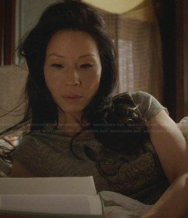 Joan's grey owl tee on Elementary