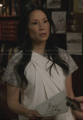Joan's grey and white pleated shift dress on Elementary