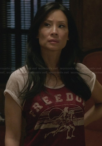 "Joan's red ""Freedom"" tshirt on Elementary"