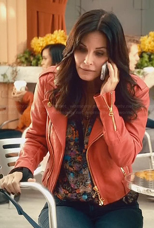 Jules's printed top and red leather jacket on Cougar Town