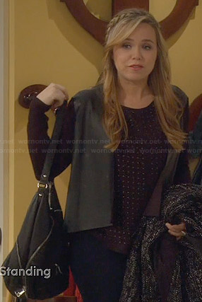 Kristin's black studded top and leather front jacket on Last Man Standing