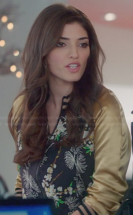 Lauren's floral bomber jacket with gold sleeves on The Crazy Ones