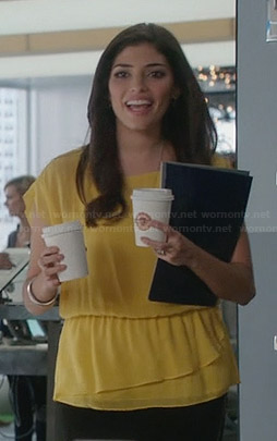 Lauren's yellow tiered hem blouse on The Crazy Ones