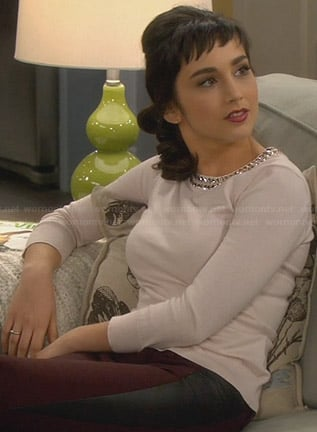 Mandy's sweater with embellished neckline and red pants with leather side panels on Last Man Standing