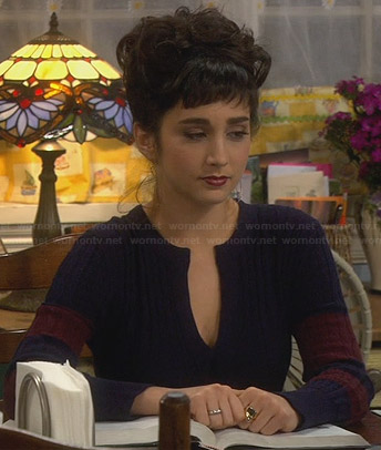 Mandy's navy and burgundy cable knit sweater with split neck on Last Man Standing