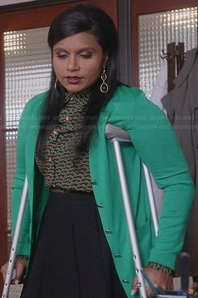 Mindy's green and gold printed shirt and green cardigan on The Mindy Project