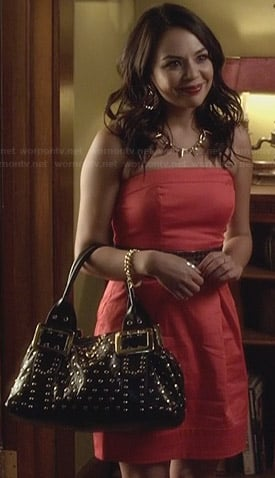 Mona's red strapless dress at black studded bag on Pretty Little Liars
