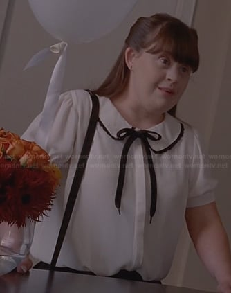 Nan's white blouse with black bow on American Horror Story