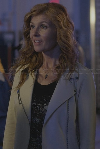 Rayna's floral skull tee and white leather moto jacket on Nashville