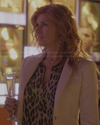 Rayna's zip-front leopard print blouse and white textured blazer on Nashville