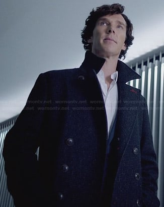 Sherlock's tweed coat with red button stitching on Sherlock
