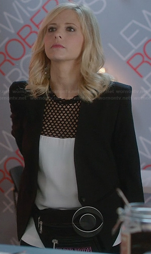 Sydney's white top with black perforated yoke and black cropped blazer on The Crazy Ones