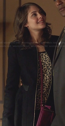 Thea's black zip front coat on Arrow