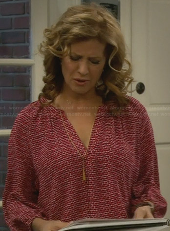 Vanessa's red printed blouse on Last Man Standing