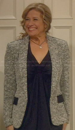 Vanessa's grey tweed blazer with black pockets and trim on Last Man Standing