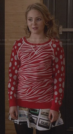 Carrie's red zebra and polka dot sweater with cassette tape skirt on The Carrie Diaries
