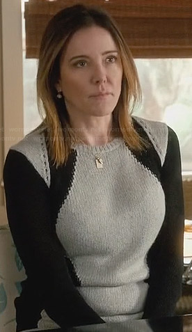 Ellie's grey and black colorblock sweater on Cougar Town