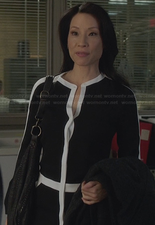 Joan's black and white contrast trim dress on Elementary