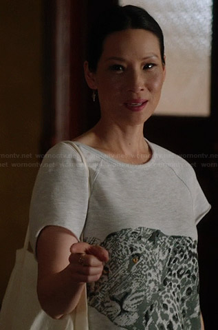 Joan's grey embellished leopard top on Elementary