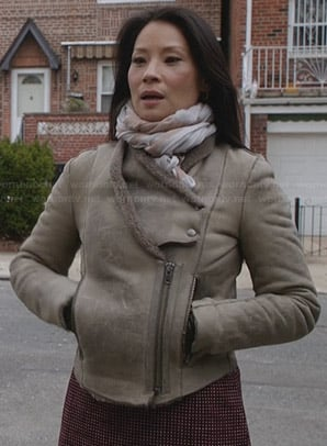 Joan's taupe shearling jacket on Elementary