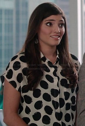 Lauren's black and white polka dot blouse on The Crazy Ones