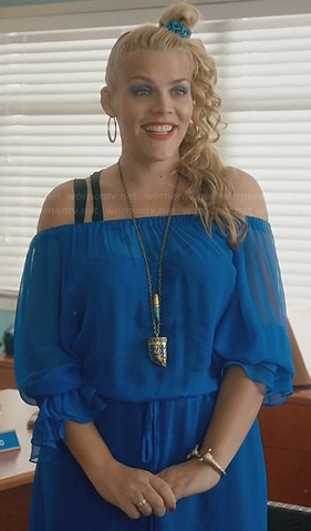 Laurie's blue off-shoulder dress and horn necklace on Cougar Town