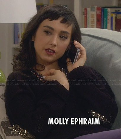 Mandy's black sweater with sequinned elbow patches on Last Man Standing