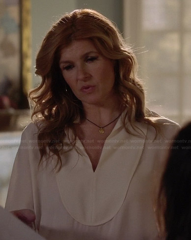 Rayna's white bib front blouse on Nashville