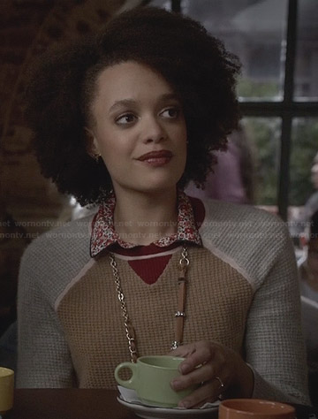 Remy's tan and grey sweater with red trim on Ravenswood