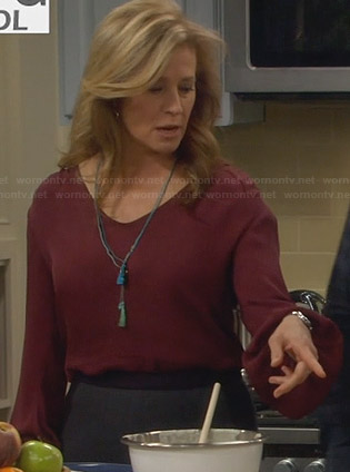 Vanessa's burgundy bishop sleeve blouse on Last Man Standing