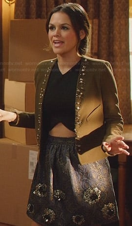 Zoe's green studded jacket and black crop top on Hart of Dixie