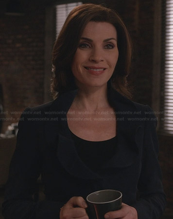 Alicia's navy jacket with ruffled collar on The Good Wife