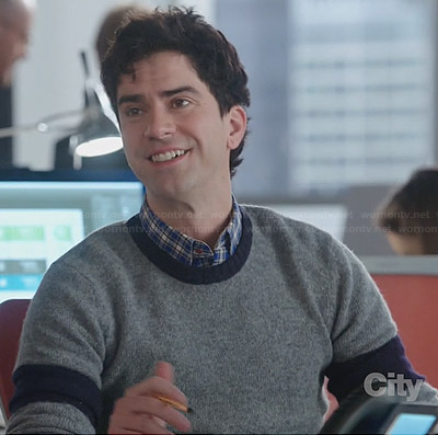 Andy's grey and navy colorblock sweater on The Crazy Ones