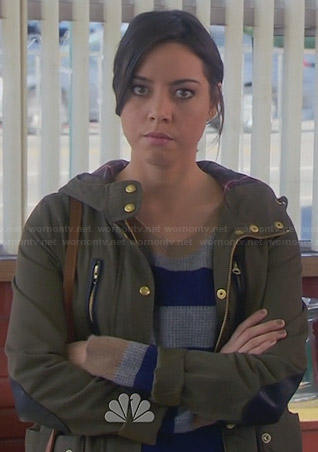 April's navy and grey striped sweater and green parka jacket with leather elbow patches on Parks and Recreation