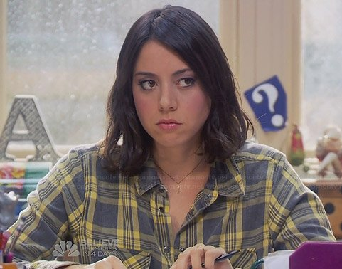 April's yellow and grey plaid shirt on Parks and Recreation
