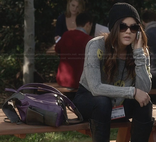 Aria's smiley face sweatshirt with open back on Pretty Little Liars